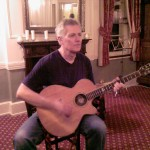Playing at the Teddington Acoustic Music Club in 2010.